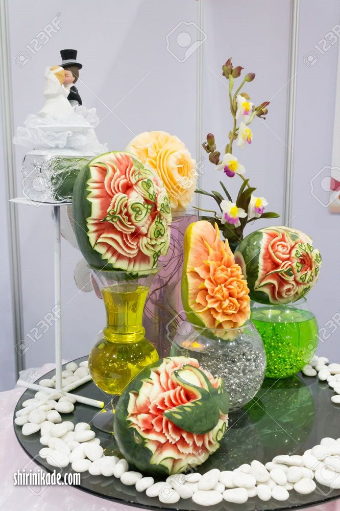Mix fruits carving on table sets.