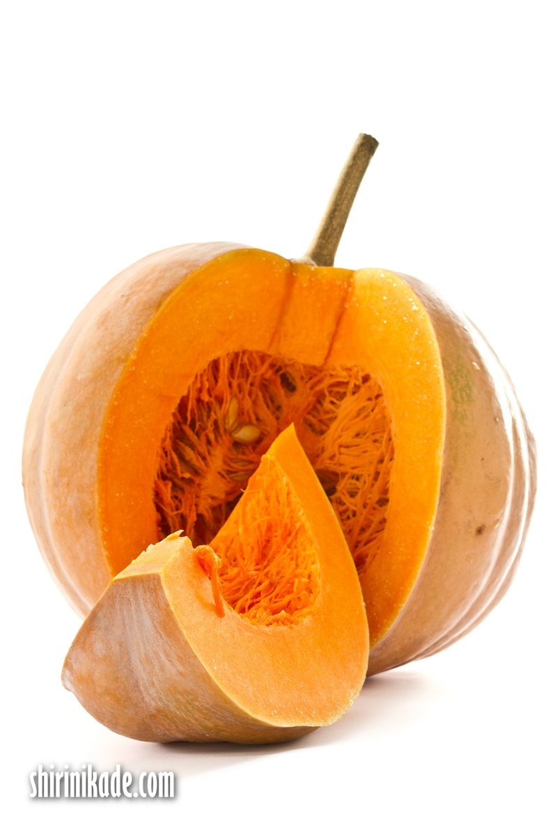 Cut a piece of ripe pumpkin on a white background